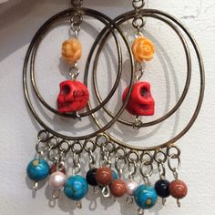 """OH SO LOVE LEIGH JEWELRY: (Leigh Palmer) """"I was born and raised in Boulder, Co but I have traveled all over. The place that resonated most with me was Mexico. I lived and studied Spanish in Guadalajara and I fell in love with the art and culture, including the bright colors, Day of the Dead and Frida Kahlo. All of these aspects influence my work. I love to incorporate The Day of the Dead sugar skulls with flowers and brightly colored beads and etching metal techniques on copper and bras"""