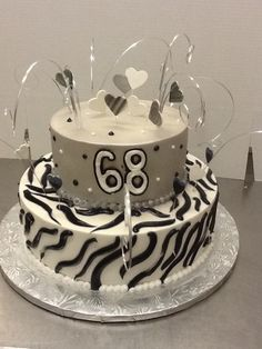 Calumet Bakery  Buttercream Cake Grey, Black, and White with Silver Bear Grass and Fondant Hearts