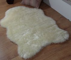 Cream ivory faux fur single sheepskin stule rug 70 x 100 cm houseware online http://www.amazon.co.uk/dp/B00BJLP7E8/ref=cm_sw_r_pi_dp_U9quub1KTY295