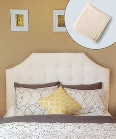 First-time upholsterer Samantha Miller created this tufted headboard from a canvas dropcloth and added a scalloped plywood back, an extra-thick layer of batting, and fabric-covered buttons she made herself. | Photo Inset: Yunhee Kim | thisoldhouse.com
