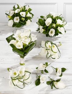 Make a dramatic entrance with this white Calla Lily wedding flowers collection.