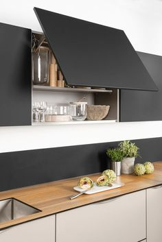 Dark, light, oak, maple, cherry cabinetry and multi wood kitchen cabinets in kerala. CHECK PIN for Lots of Wood Kitchen Cabinets. Black Kitchen Cabinets, Painting Kitchen Cabinets, Black Kitchens, Home Kitchens, New Kitchen, Kitchen Decor, Decorating Kitchen, Hidden Kitchen, Kitchen Modern