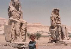 Gail Howard at Colossi of Memnon, two massive stone statues of Pharaoh Amenhotep III, have stood guard across the Nile River from Luxor, Egypt, for the past 3,400 years.  Gail Howard's Travels.
