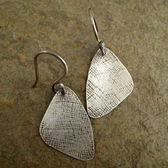 Hammered linen texture sterling silver earrings by organikx, $50.00