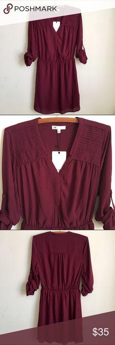 Ruby Red Dress; Daniel Rainn New with tag. Dark Ruby red/maroon dress. Above knee. Quarter length sleeves, can be undone to wear long sleeve. Elastic waist. Inside is lined. Daniel Rainn Dresses Mini
