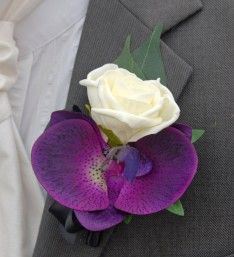 Best man or Grooms Buttonhole with an Ivory Foam Rose Purple Orchid and Black satin ribbon Bow.