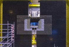 The electromagnetic calorimeter, completely assembled, is a wall more than 6 m high and 7 m wide, consisting of 3,300 blocks of scintillator, fibre optics and lead. This huge wall will measure the energy of particles produced in proton-proton collisions at the LHC when it is started in 2008. Photons, electrons and positrons will pass through the layers of material in these modules and deposit their energy in the detector through a shower of particles. May 17, 2005. (© CERN)