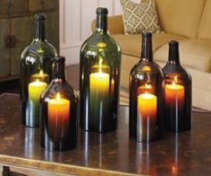 Cut the bottoms off wine bottles to use for candle covers. It keeps the wind from blowing them out when outside.