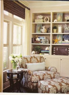 warm colors, curated shelves,dramatic large print on chair  --  ciao! newport beach: decorating with sea shells