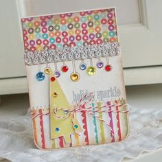 love the paper and the co ordination of circle paper, circle bling (use candies).