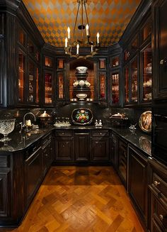 Bella Sera mansion Old World Victorian kitchen interior with dark wood cabinets