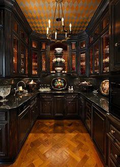Bella Sera mansion Old World Victorian kitchen interior with dark wood cabinets
