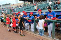 "Getting autographs from players before Sunday's ""Kids Run the Bases"""