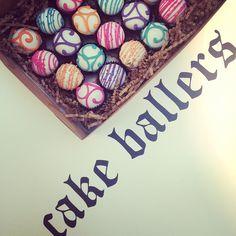 cake ballers cake  balls! Colorful swirl-y cake balls all boxed up and ready to go! www.cakeballers.com #thecakeballers #cakeballers #cakeballer #swirl #pink #teal #purple #orange #boiseballers #eatmorecakeballs #weballcake #idaho #cakeball #branding #ballin #ballereveryday #cakeballersloveboise