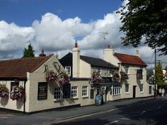 https://flic.kr/p/8zw4f2 | Paul Pry Pub - Rayleigh | Paul Pry Pub, looking very pretty, with blue sky and fluffy clouds.