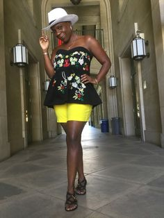 A cheerful outfit that offers hope and joy - an embroidered floral corset, bright yellow shorts and white wide brim fedora at So What to Twenty!: Wind Beneath My Wings
