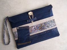 Upcycled denim clutch wristlet made from by HarvestHomeStudio  denim, linen, batik and Bavarian button
