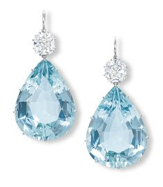 Pair of aquamarine and diamond ear pendants - Each suspending a pear-shaped aquamarine, to the old-mine and cushion-shaped diamond surmount weighing 3.10 and 3.06 carats, mounted in platinum, 5.3 cm long.