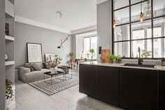 Grey walls and a steel-framed indoor window Small Space Living, Small Spaces, Living Spaces, Living Room, Living Area, Hay Tray Table, Scandi Living, Kitchen Living, Kitchen Grey
