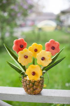 Tropical fruit bouquet in a pineapple vase