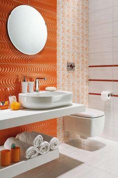 petite salle de bain colorée décorée d'un carrelage mural orange à motif ondulé et carrelage blanc à motifs orange