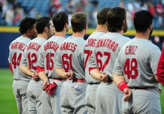 Members of the St. Louis Cardinals stand for the national anthem before the game against the Atlanta Braves at Turner Field. Cards won the game 7-1. 5-07-14