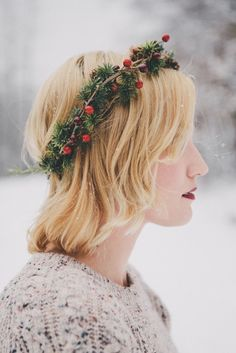 Trim your locks with this wintry version of a flower crown, made of spruce sprigs, holly berries and mini pine cones.