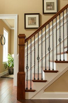 This is our staircase railing. Craftsman Staircase with High ceiling, Wainscotting, Chair rail, Hardwood floors Wrought Iron Stair Railing, Wood Railing, Staircase Railings, Staircase Design, Banisters, Staircases, Iron Spindle Staircase, Black Staircase, Interior Railings