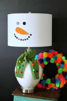 Cute snowman lamp. Made with buttons and felt!
