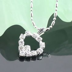 Magnifique collier pendentif en argent en forme de cœur