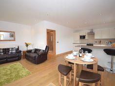 Open-plan lounge/kitchen/diner at Straddie Cottage