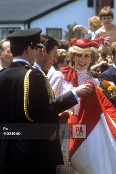June 14, 1983 The Prince of Wales amuses the Princess by appearing to liken a flag to the colours worn by his wife, in Halifax, Canada