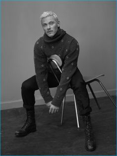 Sitting for a black & white portrait, Luke Evans dons an Ermenegildo Zegna Couture sweater and pants with vintage leather boots for Interview.