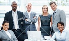 Portrait of happy and confident business people smiling