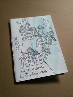 Handmade notebook. Zentangle and doodle city illustration. Watercolor and ink pen
