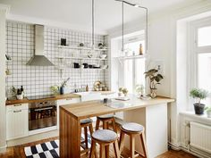 A kitchen island like this- storage, table, and you can tuck the chairs under to save space