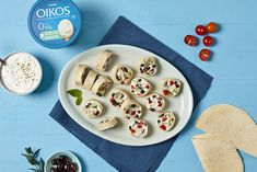 Swap cream cheese with a blend of Greek yogurt and feta cheese, a fresh, light taste that will add a nutritious touch to your pinwheels! Frozen Greek Yogurt, Greek Yogurt Recipes, Peanut Butter Protein Bars, Peanut Butter Cheesecake, Lassi, Yogurt Banana Bread, Tortilla Pinwheels, Chocolate Yogurt, Blue Cheese Sauce