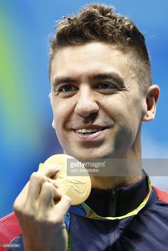 USA's Anthony Ervin celebrates with his gold medal after the Men's 50m Freestyle…