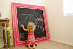 How cute is this for the playroom?  Paint a large, cheap piece of wood with chalkboard paint and frame with molding.