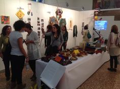 Visitors at the exhibition looking at handicrafts made during the experimentation Bologna, Art Therapy, 30 Years, Handicraft, Finals, Presentation, Craft, Arts And Crafts, Final Exams