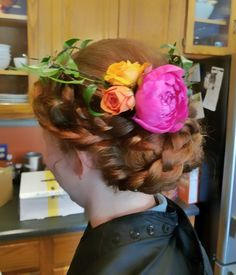 Braided updo with flower crown for the bridesmaid, by Shana Montgomery owner of Fringe Theory Salon.