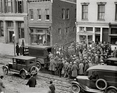 "January 31, 1925. Washington, D.C. ""Police raid on gamblers' den. E Street between 12 and 13th."""