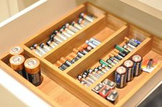 Use a flatware drawer tray to organize batteries.