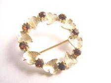 Vintage Gold Tone Garnet  Brooch Pin Flower Rhinestone http://www.ebay.com/itm/Vintage-Gold-Tone-Garnet-Brooch-Pin-Flower-Rhinestone-/131477921121?pt=LH_DefaultDomain_0&hash=item1e9cb1dd61