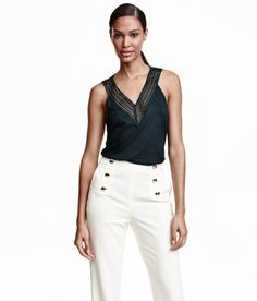 Check this out! Sleeveless jersey top with a V-neck, lace at top, racer back, and gentle flare to hem. - Visit hm.com to see more.