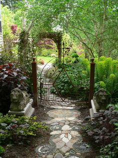 Garden metal gate and stone walkway