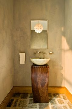 awesome idea for a bath when you don't need storage. Beautiful simple yet elegant rustic bathroom with a wooden stump base, stone vessel sink, flagstone floor, and stucco walls for a distinctive European Villa look. By Witt Construction. Small Bathroom Vanities, Vessel Sink Bathroom, Chic Bathrooms, Bathroom Ideas, Wood Bathroom, Small Bathrooms, Simple Bathroom, Minimal Bathroom, Narrow Bathroom