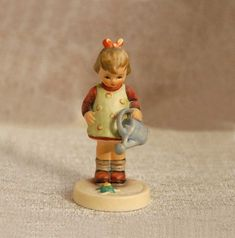 Goebel Hummel Ceramic Figurine Little Gardener Statue Girl with Watering Can The Missing Bee West Germany Marked Vintage by NutmegCottage on Etsy Goebel Figurines, Hummel Figurines, Crochet Home Decor, Crochet Art, Modern Victorian Decor, Home Decor Items, Ceramic Pottery, Arts And Crafts, Art Crafts