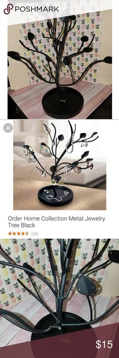 Tree Jewelry Holder Metal tree jewelry holder in black. Used but in good condition. Slight cosmetic damage at the base. But does not affect the structure or function. This is a beautiful piece. Jewelry