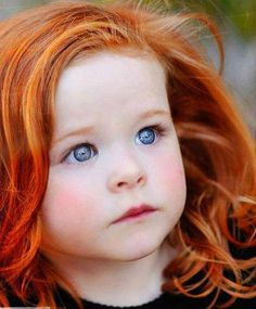 blue eyes and adorable red hair.I hope my kids have pretty red hair